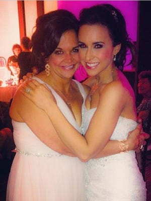 Lacy Chabert posted this photo of her on her wedding day with her sister.