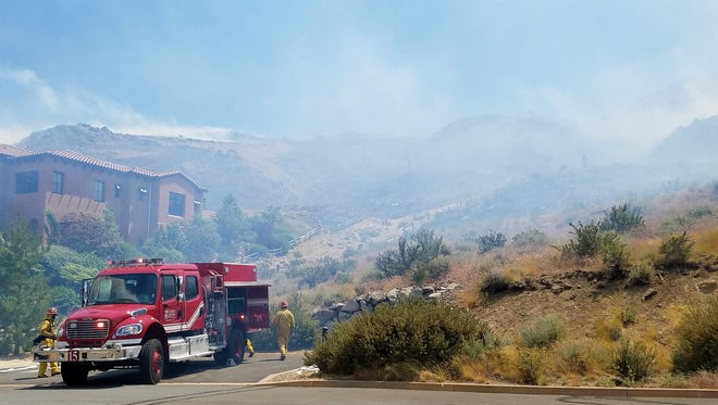 Truckee Meadows Fire Protection District firefighters work on the Hawken Fire last year.