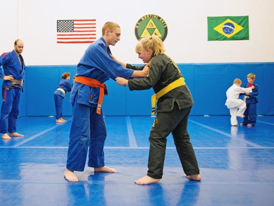 James Stethers and Hailey Traver, of Binghamton, spar during youth Brazilian jiu-jitsu class at B.C. Martial Arts Academy.