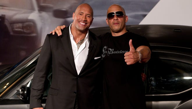 Vin Diesel, right, and Dwayne Johnson were all smiles at the 'Fast Five' premiere in Rio de Janeiro in 2011.