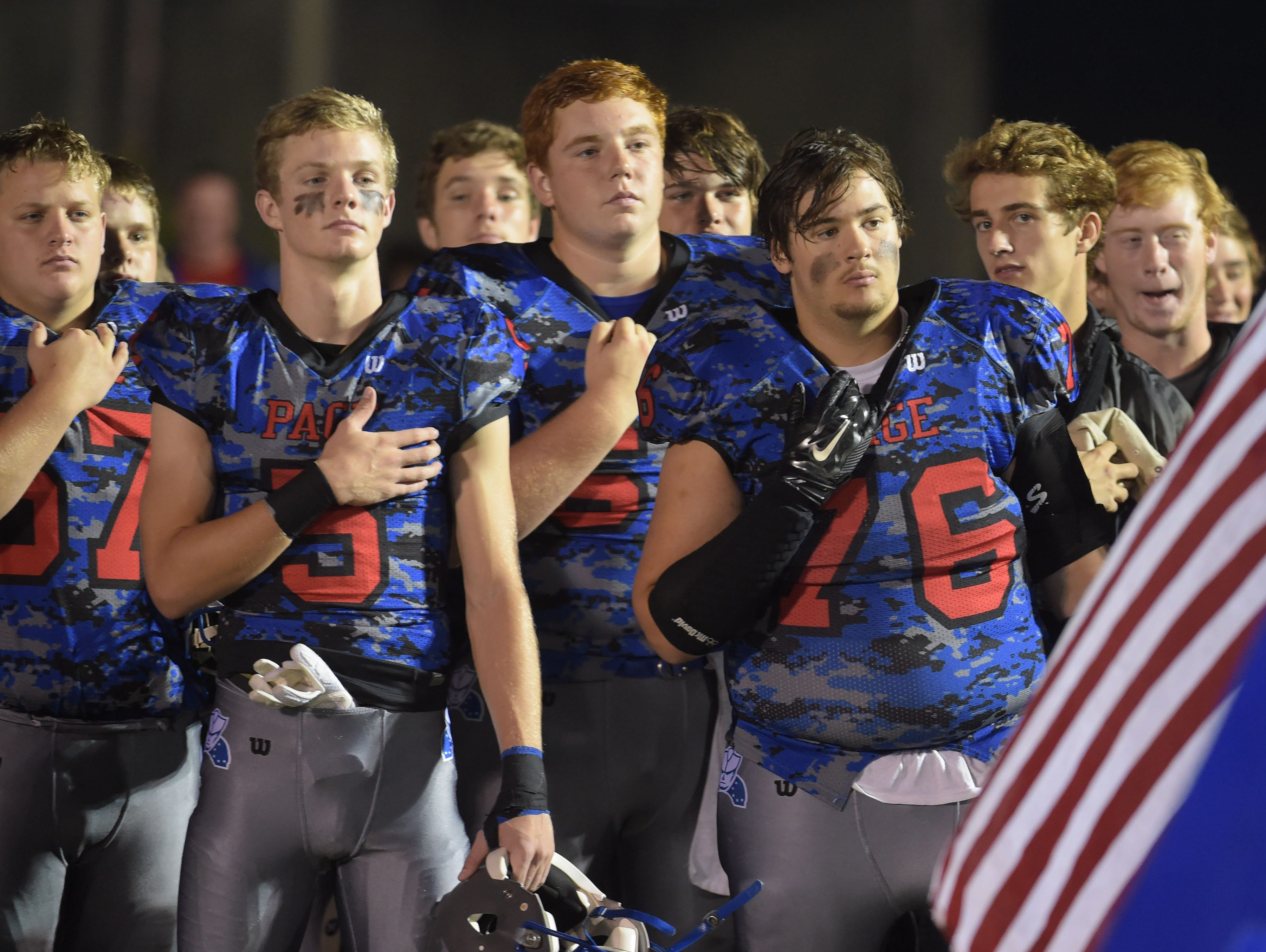 Page High School football players say the Pledge at Page High School on Friday Sept. 25, 2015, in Franklin in Tenn.