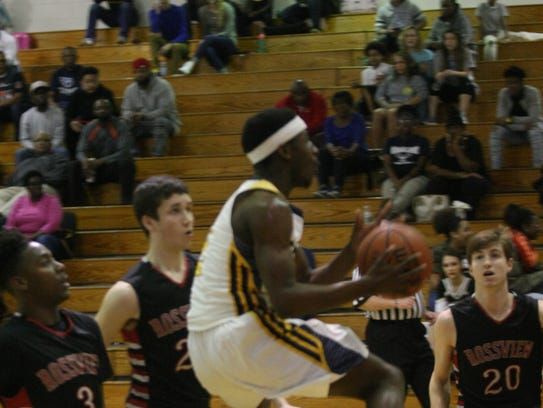 Northeast's Quinton Cross glides into the lane for