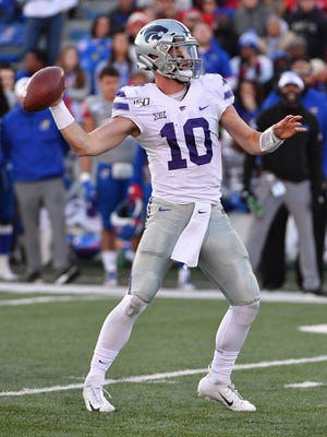 Kansas State quarterback Skylar Thompson throws a pass in last year's game at Kansas. The Fort Osage graduate is concerned that Tuesday's decisions by the Big Ten and Pac-12 may take away his senior season in college.