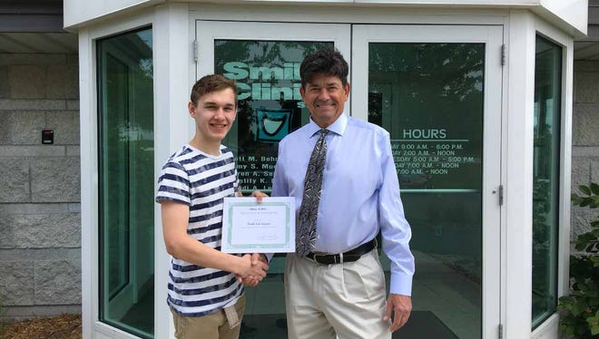Kiel High School graduate Noah Lierrman recently received a $500 scholarship from the Smile Clinic in Manitowoc. Lierrman will begin his studies at Silver Lake College in the fall. Presenting the scholarship was Dr. Scott Behringer.