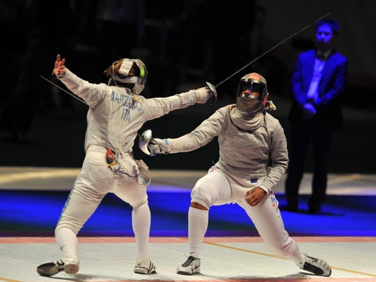 Ibtihaj Muhammad (right) competes with Italy's Gioia