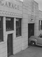 A Coca Cola delivery van enters the garage of the bottling facility. Sept. 27, 1955.
