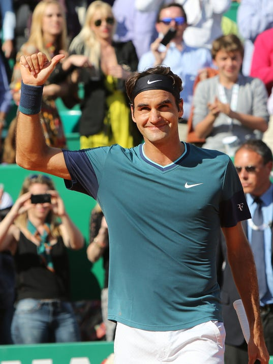 Roger Federer of Switzerland  acknowledges applause after defeating Novak Djokovic of Serbia, in their semifinal match of the Monte Carlo Tennis Masters tournament, in Monaco, Saturday, April, 19, 2014. Federer won 7-6, 6-2. (AP Photo/Claude Paris)