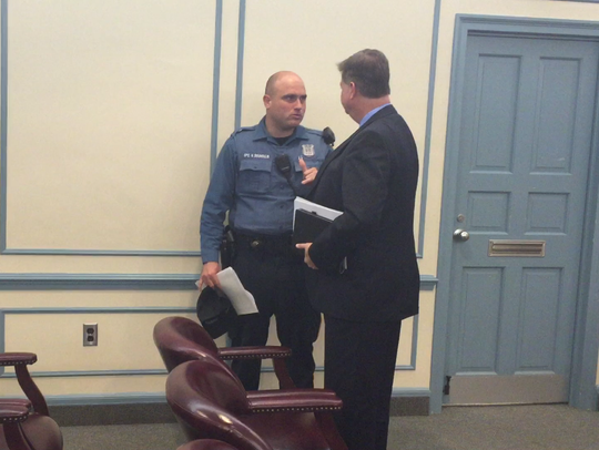 Vineland police Officer Nicholas Dounoulis speaks with
