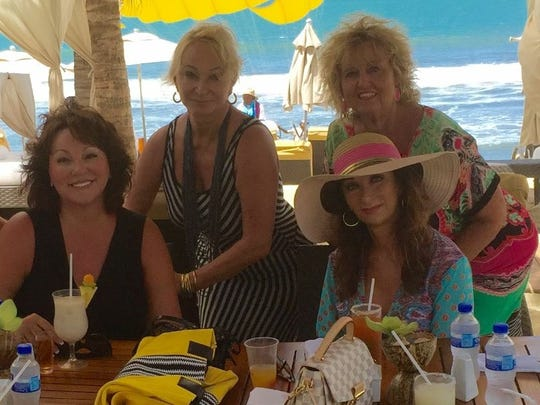 """Hat girls The lunch group  known as """"The Hat Girls"""" spend some serious girlfriend time recently in Puerto Vallarta, Mexico, celebrating being """"fabulous at 60!"""" Posing in their fabulousness are from left Kat Sanders, Debra Orman, Julie Nelson, Collyn Pearl and Cynthia Wolfe."""