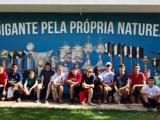 Local soccer players from schools like Washington and Pace pose for photos in front of the Cruzeiros FC complex during a trip to Brazil over Thanksgiving Break.