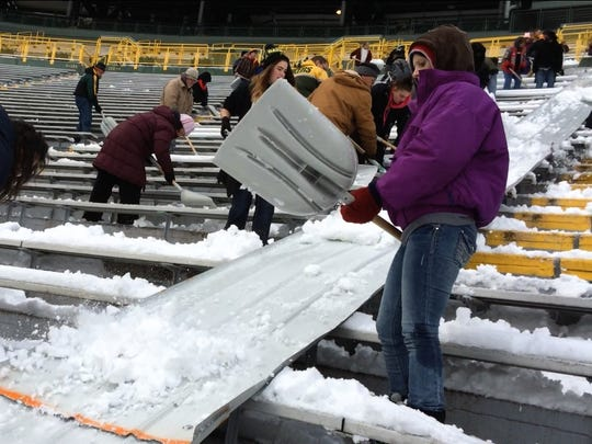 People shovel snow at Lambeau Field on Saturday, Nov. 29, 2014. Adam Rodewald/Press-Gazette Media