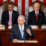 "Israeli Prime Minister Benjamin Netanyahu speaks before a joint meeting of Congress Tuesday. Netanyahu said the world must unite to ""stop Iran's march of conquest, subjugation and terror."" House Speaker John Boehner of Ohio, left, and Sen. Orrin Hatch, R-Utah listen."