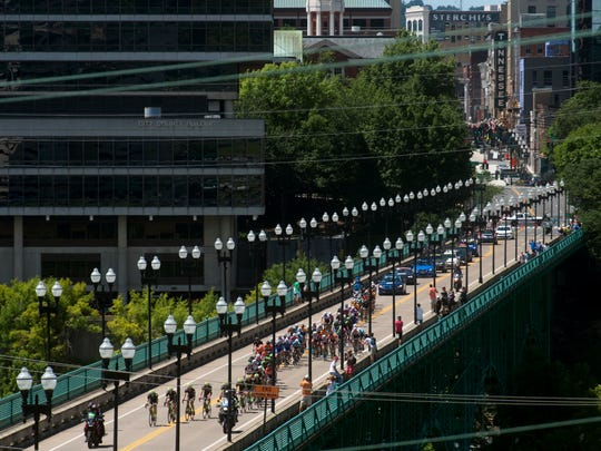 Cyclists cross the Gay St. Bridge in the USA Cycling