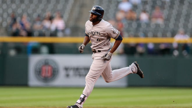 The Brewers' Lorenzo Cain rounds the bases on a solo home run in the first inning.