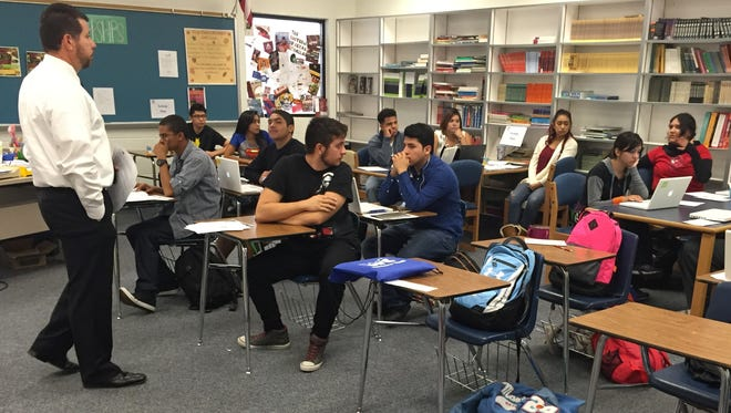 Anthony High School seniors ask questions about applying for college scholarships on Oct. 28.