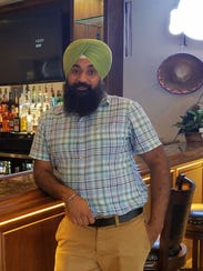 Bombay Spice owner and manager Jagtar Singh is happy