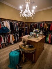 A crytal chandelier and special drawers just for jewelry make Sharon Moss's closet sing, Tuesday, Nov. 10, 2015.