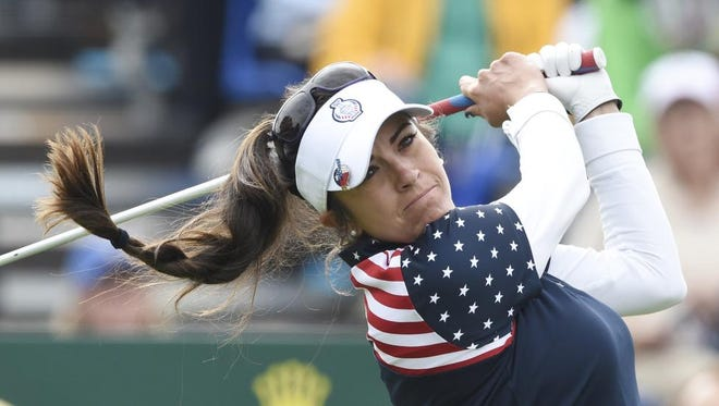 United States' Gerina Mendoza Piller tees off in the singles matches on Day3 of the Golf Solheim Cup in St.Leon-Rot, Germany on Sunday. Piller's key win helped guide the Americans to the title.