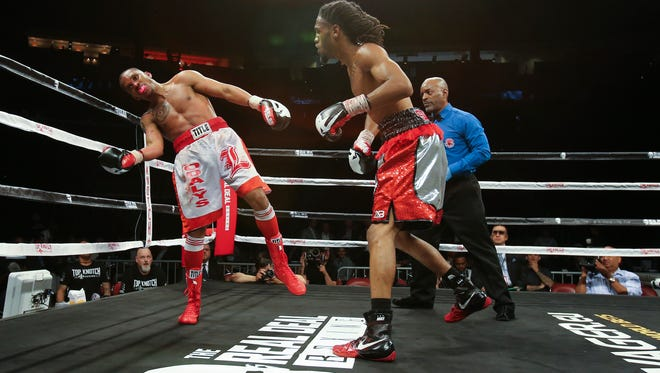 Trevis Burgos, right, delivered the blow that led to a TKO of opponent Yunier Valdes during their match in the Jose Sulaiman World Invitational Tournament at the Yum Center in Louisville.    Apr. 27, 2018