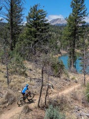 Rider prepares to round  curve on the Grindstone Trails.