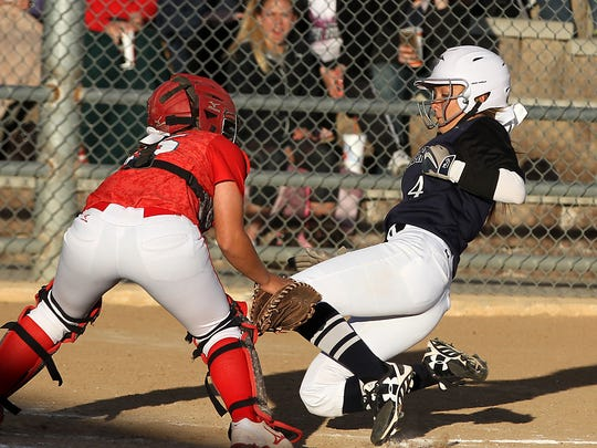 Piedra Vista baserunner Tyra Garcia is tagged out at