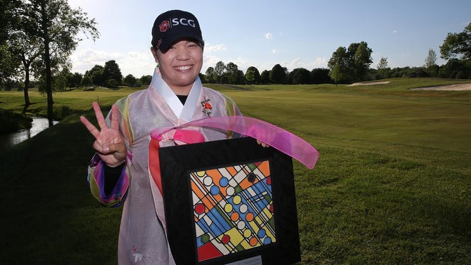 Ariya Jutanugarn holds the Volvik Championship trophy after her third straight LPGA victory.