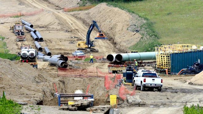 Workers build the Rover Pipeline in Stark County in 2017.