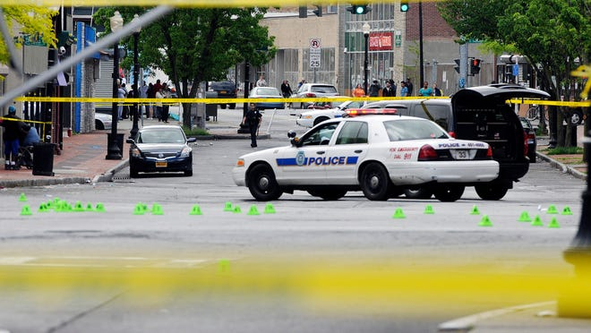 City of Poughkeepsie police investigate the scene on Main Street that left one man dead and an officer injured after an incident early Saturday morning.