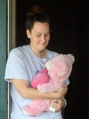 Jessica Kennedy, 29, of Oakland holds a teddy bear her husband, Clay Kennedy, gave her after she was diagnosed with cervical cancer. Doctors have given Kennedy a three month window to get pregnant via in vitro fertilization before she needs a hysterectomy.