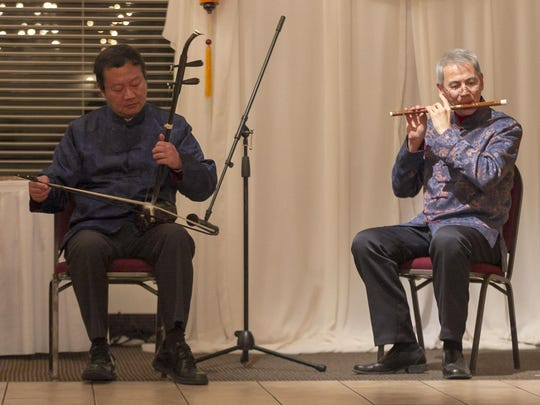 Xinhua Zha, left, plays an erhu (a Chinese 2-string violin) while Han Wang plays a Chinese bamboo flute during the Asian Art Society of Monterey Bay annual gala at Rancho Canada Golf Club on Tuesday, January 31, 2017 in Carmel-By-The-Sea, Calif. -- Vernon McKnight/for Off 68