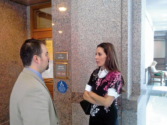 State Rep. Bill Moody speaks with Kerri Kasem outside a hearing room in Austin Tuesday. A committee was discussing a bill intended to allow family members to see loved ones despite the wishes of caretakers. Kasem was not able to see her father, deejay Casey Kasem, until just before his death because Casey Kasem's second wife didn't allow it.