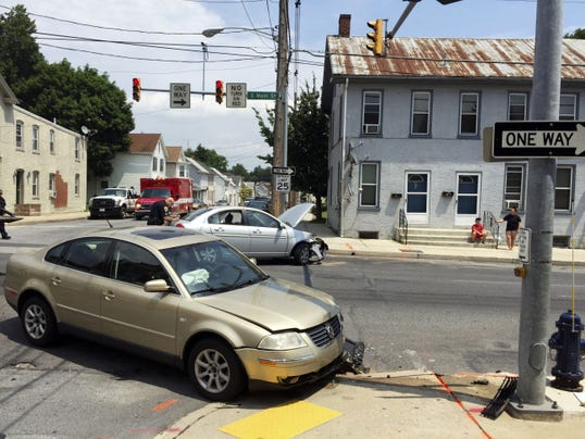 Three people were injured when two cars collided at the intersection of South Main and Catherine streets Monday afternoon in Chambersburg.   (Sarah Davis -- Public Opinion)