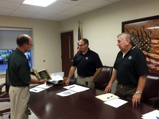 South Lebanon Township Chairman Ronald Arnold was presented with a clock Tuesday for his 35 years of service to the township, which ended with that evening's meeting. From left are township Manager Jim Loser, township Vice Chairman David Eggert and Arnold.