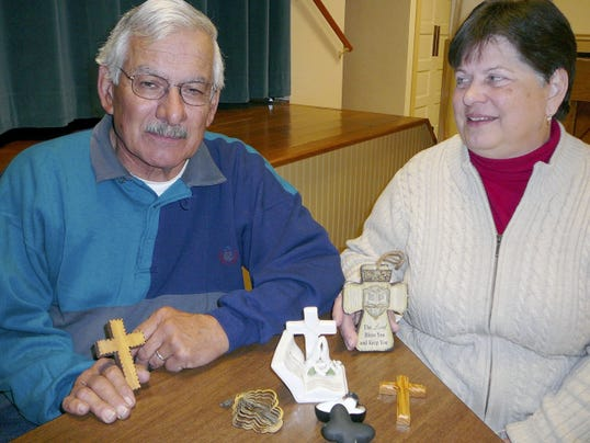 Dave and Betty Evelhoch, Walnut Bottom, on March 28 show the five crosses that gave them signs of hope after a Feb. 13 fire that destroyed their home.