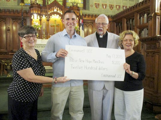 New Hope Ministries received a donation during Mission Sunday at Emmanuel UCC, 124 Broadway, Hanover, from Emmanuel's Mission Savings Account. From left, are Carol Giesey (chair, mission and outreach), Mike Fleming of New Hope Ministries accepting a donation of 1,200, Rev. Uble Frost (interim pastor at Emmanuel), and Peg Moulton (member of mission and outreach).
