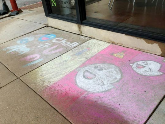 Chalk art in front of Miscreation Brewing Company in Hanover survives a Monday morning rainstorm a few days after the borough's annual Chalk It Up event.