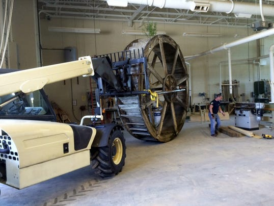 The water wheel from Chambers Fort Park is rolled into Franklin County Career and Technology Center for repairs.