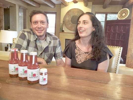 Jacob Seidenberg Korn and Carmit Levin talk about Hatchup Katchup on July 14, 2015 in Santa Fe, N.M.   Levin and Seidenberg Korn, both 35, are now preparing to open a Santa Fe commercial kitchen in August to ramp up production of Hatchup Katchup. Theyíre eager to set up shop closer to home.   (Justin Horwath/Santa Fe New Mexican via AP) MANDATORY CREDIT