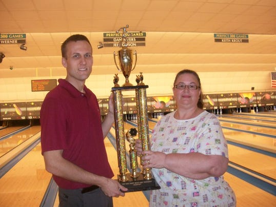 Greg Bruff, left, accepts the 2015 Bud Light York County Match Play Championship trophy from Sherry Wagman of Lincolnway Bowling on Sunday. Bruff collected 1,000 for the win.