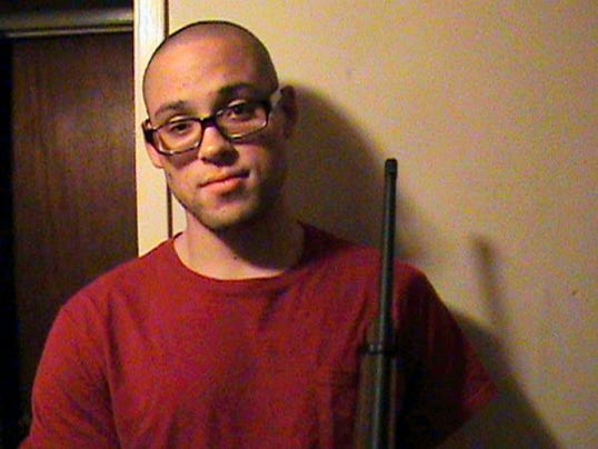 This undated photo from a MySpace page that appeared to belong to Chris Harper Mercer shows him holding a rifle. Authorities identified Mercer as the gunman who went on a deadly shooting rampage at Umpqua Community College in Roseburg, Ore., on Thursday, Oct. 1, 2015. (MySpace via AP Photo)