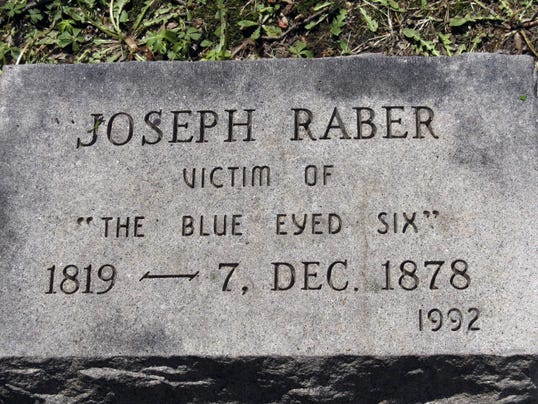 A stone marks the grave of Joseph Raber in the Moonshine Church Cemetery, along Route 443.