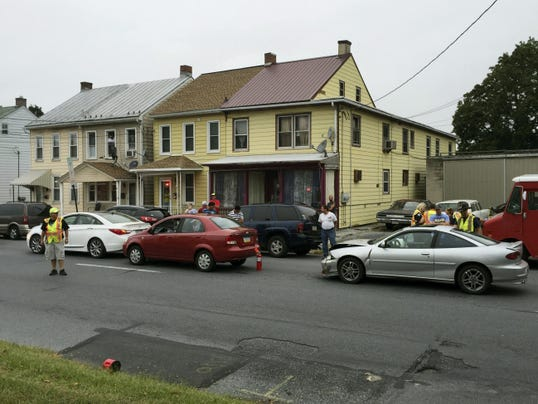Emergency crews work at the scene of a crash Saturday morning at East Cumberland Street and Second Avenue.