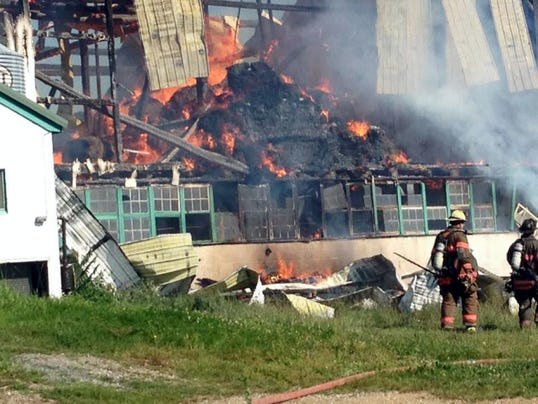 A barn is destroyed by fire Thursday at 979 Boyer Mill Road in Hamilton Township.