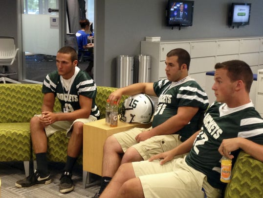 From left, James Buchanan football players Seth Carbaugh, Dustin Walker and Dillon Sanders are interviewed on Tuesday during the Mid Penn Conference Media Day.