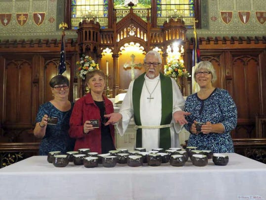 """Thirty-three """"Blessings Cups"""" were dedicated during the recent worship service at Emmanuel UCC, 124 Broadway, Hanover. Each Blessings Cup is made by hand, and no two are alike, symbolizing each person's uniqueness and individuality. Warmth and tactile stimulation of the ridges formed from turning on the potter's wheel can be felt when holding the cup. The details of the Rose Window are etched into the bottom, the entwined hands united around the rim of the cup, and the word """"blessings"""" inscribed. The Missions & Outreach Committee of Emmanuel is selling the """"Blessings Cups"""" for 15. These are on display in King Auditorium. When the four remaining cups have been sold, another order will be placed with Sally Becker. From left, are: Carol Giesey, Sally Smith, Rev. Uble Frost and Sally Becker. To purchase or order Blessings Cups, call 717-632-8281. Orders must be received no later than Oct. 15, and will be available no later than Nov. 15."""