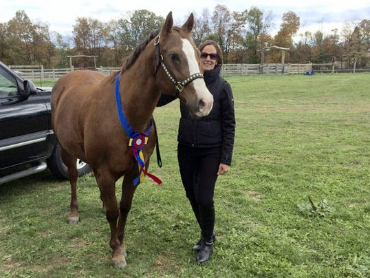 Rose Schierl of Palmyra poses with her quarter horse mare, Rosie. Rose and Rosie were champions of the Intro-Walk Only division at the recent Rudy Horsemanship Trail Obstacle Challenge Finals at Rudy Horsemanship, 81 Huckleberry Road, Jonestown.
