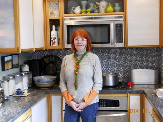 Susan McDaniel is shown in her McKenzie Street kitchen. McDaniel will be part of the Spring Market Faire of Kitchens tour April 27.