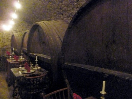 Diners can sit next to 19th-century lagering barrels in the Catacombs restaurant.
