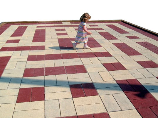 Three-year-old Annie McPherson tries her luck in the Maize Quest Tile Maze a couple of years ago. For older guests, the challenge is to reach the center of the maze by making only right turns on the path. Maize Quest opened in 1997 with a single corn maze, and the maze remains its main attraction. The park has grown, and owner Hugh McPherson now licenses out the Maize Quest program to more than two dozen farms around the country and in England.