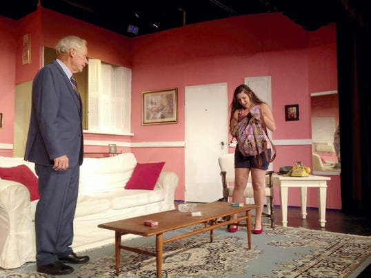 "James Robert Clark, playing Barney Cashman, talks to Courtney McDougall, playing Bobbi, on Tuesday during a rehearsal of ""Last of the Red Hot Lovers"" on Tuesday at Hanover Little Theatre."